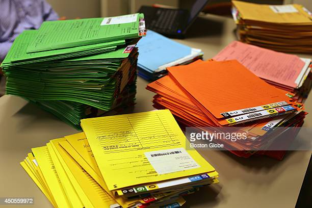 Hundreds of files from one landlord Anwar Faisal on a desk at the Housing Court at Boston Municipal Court