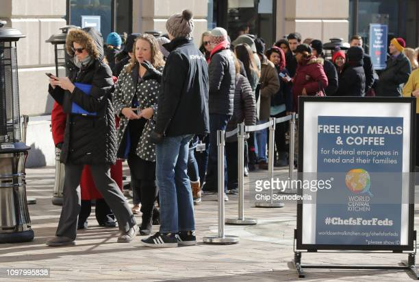 Hundreds of furloughed federal workers line up outside the World Central Kitchen in downtown January 22, 2019 in Washington, DC. Founded by celebrity...