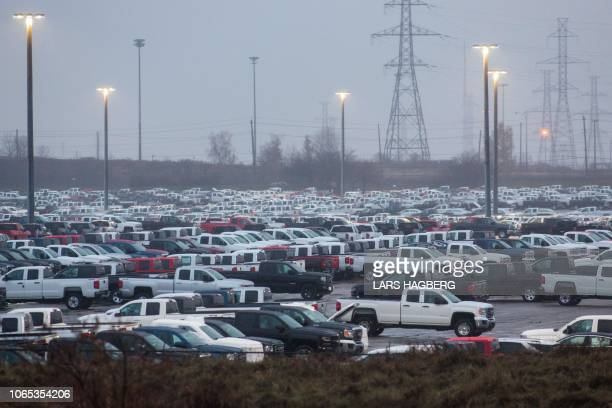 Hundreds of General Motor vehicles are parked outside the GM Assembly plant in Oshawa Ontario on November 26 2018 General Motors is to announce on...