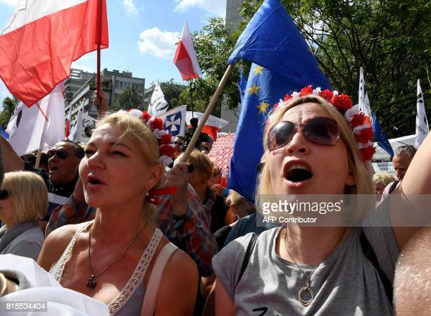 Hundreds of government opponents protest in front of the parliament building in Warsaw on July 16 2017 against new legislation that reorganizes...