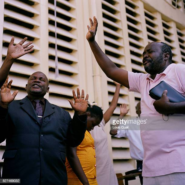 Hundreds of Haitians pray at The Church of God Rue de Centre 3 during the Sunday service The church was damaged during the earthquake with many of...