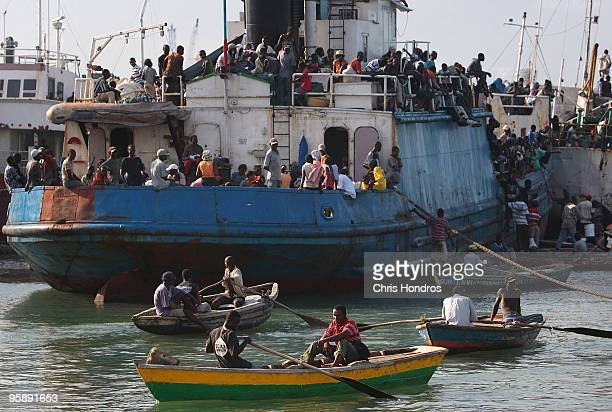 Hundreds of Haitians stand on a crowded ship docked off the coast January 20 2010 in PortauPrince Haiti Thousands of earthquakedisplaced Haitians...