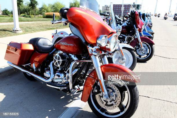 Hundreds of HarleyDavidson motorcycles from around the world line the street outside the HarleyDavidson Museum to commemorate the HarleyDavidson...