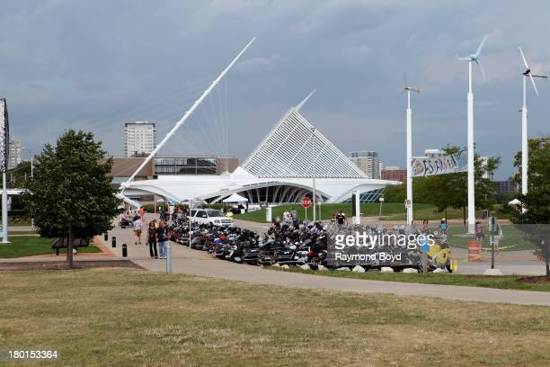 Hundreds of HarleyDavidson motorcycles from around the world line the streets outside Discovery World with the Milwaukee Art Museum in the background...
