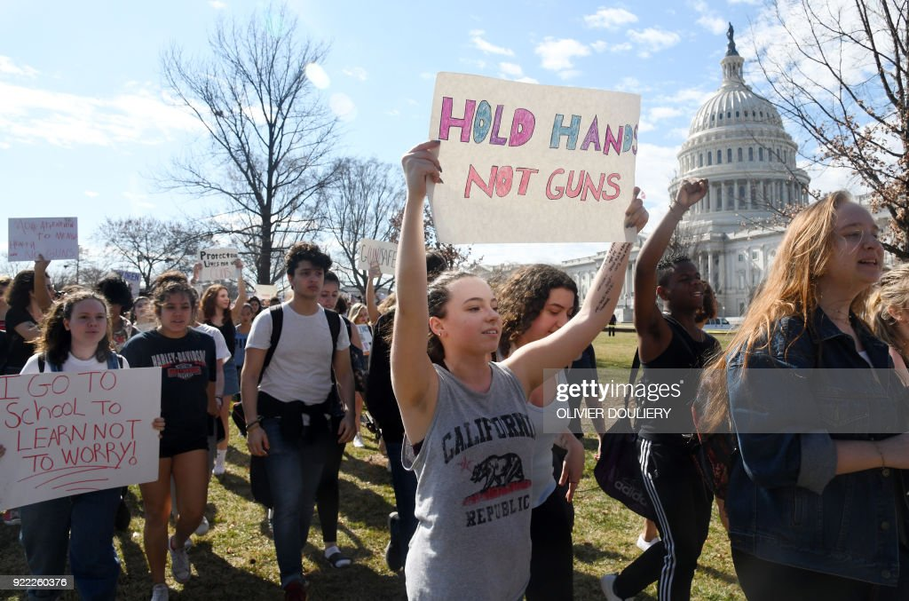 Hundreds of high school and middle school students from the District of Columbia, Maryland and Virginia staged walkouts and gather in front of the Capitol in support of gun control in the wake of the Florida shooting February 21, 2018 in Washington, DC. / AFP PHOTO / Olivier Douliery