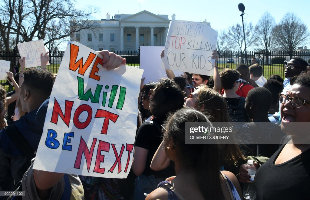 TOPSHOT - Hundreds of high school and middle school students from the District of Columbia, Maryland and Virginia staged walkouts and gather in front of the White House in support of gun control in the wake of the Florida shooting February 21, 2018 in Washington, DC. / AFP PHOTO / Olivier Douliery