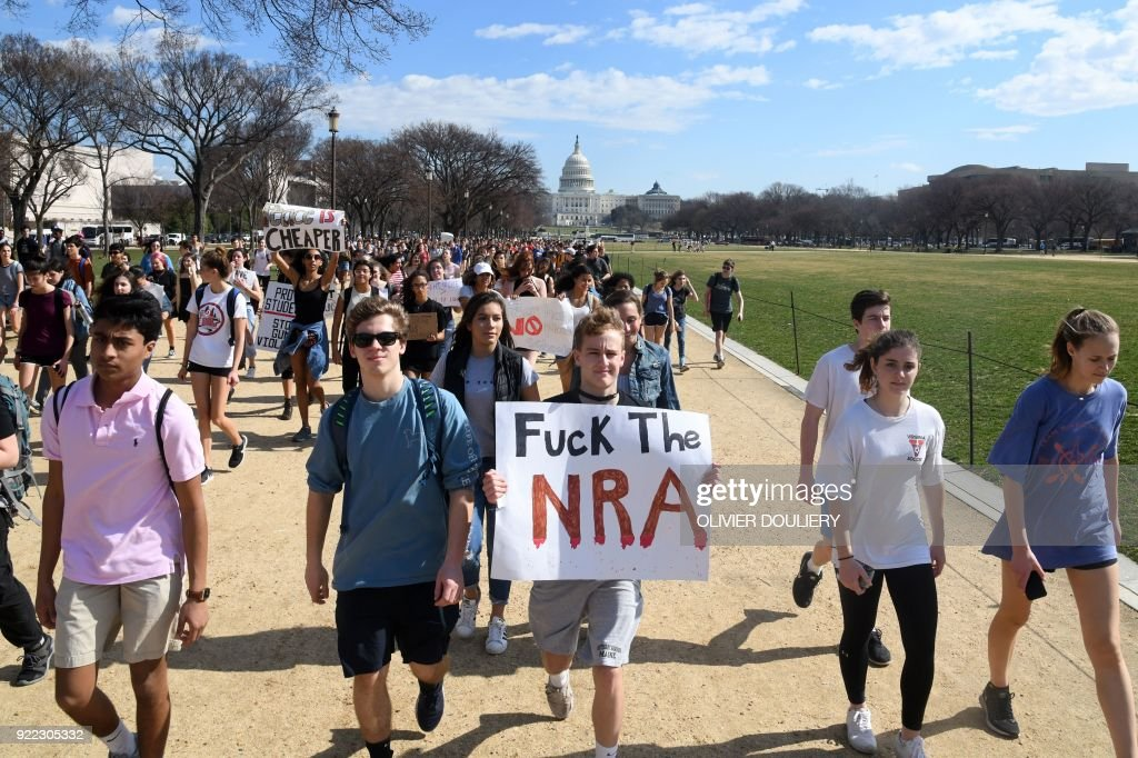 Hundreds of high school and middle school students from the District of Columbia, Maryland and Virginia staged walkouts and gathered in front of Capitol Hill (background) and the White House in support of gun control in the wake of the Florida shooting February 21, 2018 in Washington, DC. / AFP PHOTO / Olivier Douliery