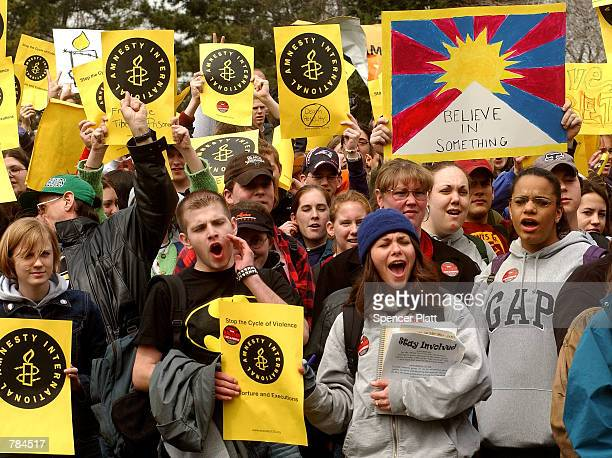 Hundreds of high school students shout slogans April 8 2002 as part of Amnesty International's National Week of Student Action in New York City The...