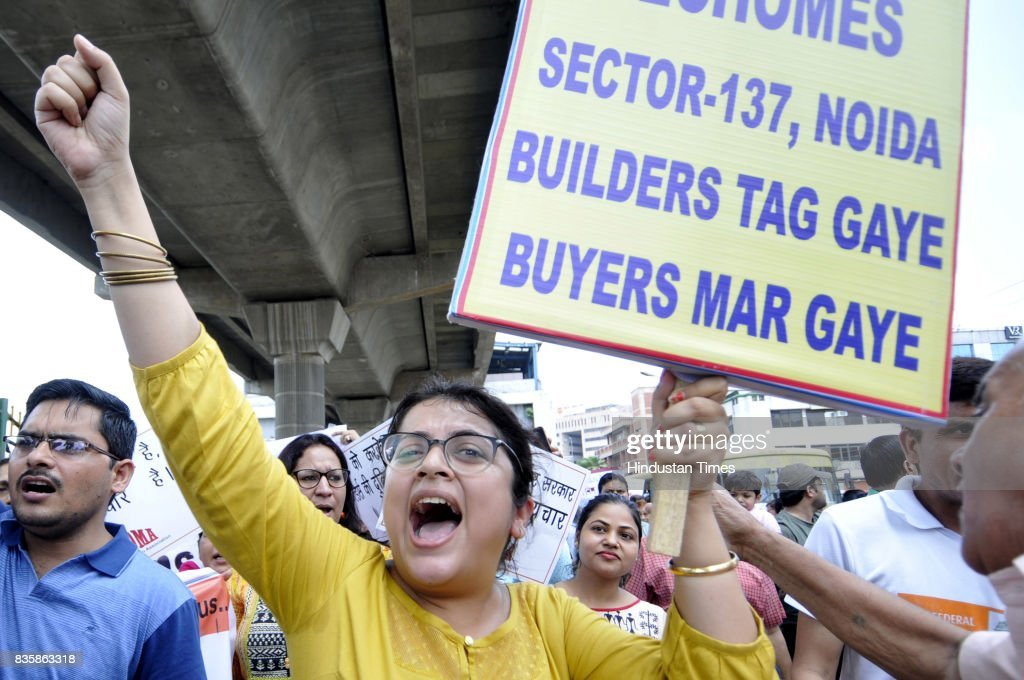 Hundreds of home buyers stage a protest against alleged delay in several home projects, on August 20, 2017 in Noida, India. The homebuyers urged Uttar Pradesh Chief Minister Yogi Adityanath and Prime Minister Narendra Modi to intervene. They also want the government agencies to take over the projects and ensure delivery of their flats.