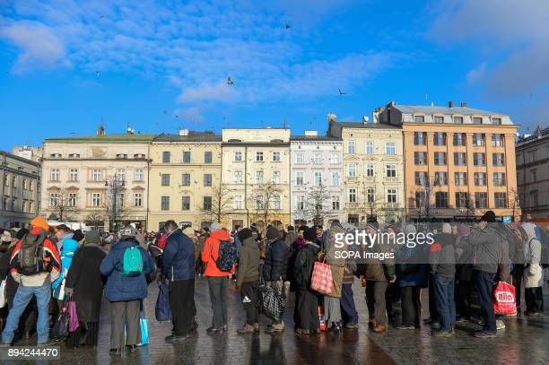Hundreds of homeless and needy people seen queuing up as they take part in the 21st Edition of the Biggest Christmas table in Europe at the Main...