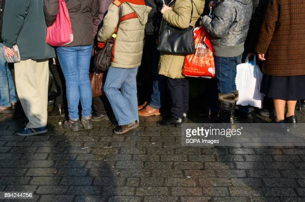 Hundreds of homeless and needy people seen queuing up during the 21st Edition of the Biggest Christmas table in Europe at the Main Square in Krakow...