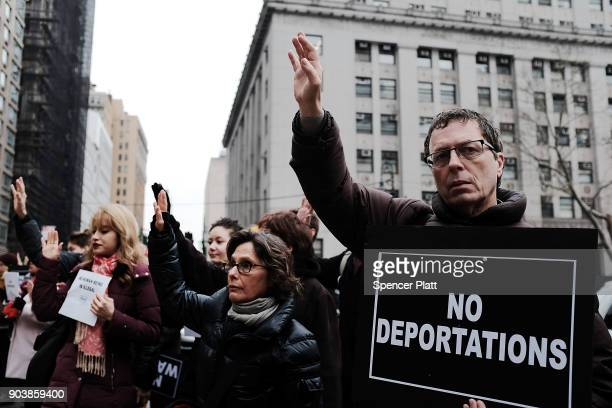 Hundreds of immigration activists clergy members and others participate in a protest against President Donald Trump's immigration policies in front...