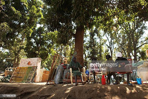 Hundreds of internally displaced south Sudanese who have recently returned from the north of the country sit with their belongings at a port in the...