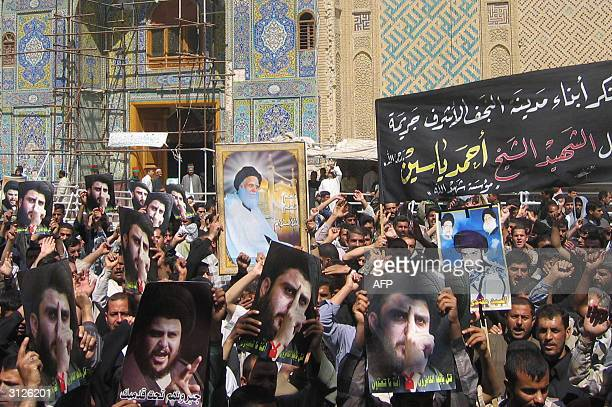 Hundreds of Iraqis Shiite Muslims holding portraits of firebrand cleric Moqtada alSadr and his late father Mohammed Sadeq who was killed by Saddam...