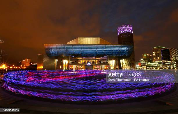 Hundreds of joggers wearing special suits with led lights attached arrive outside the Lowry Theatre in Salford Quays Greater Manchester Around 400...