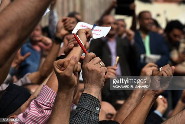 Hundreds of journalists demonstrate outside the Journalist Syndicate headquarters in Cairo on May 4 2016 calling for the sacking of the interior...