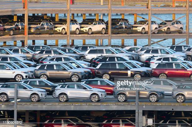Hundreds of Land Rovers made by British multinational car manufacturer Jaguar Land Rover in a multistorey car park awaiting shipping at the Port of...