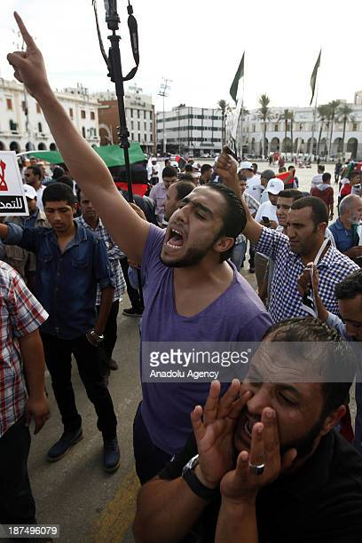 Hundreds of Libyans gathered in Martyrs Square shout slogans during a protest against an extended mandate of the General National Congress on...