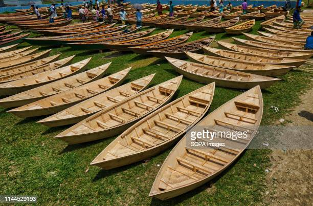 Hundreds of little wooden boats seen displayed for sale at a market as locals prepare for monsoon season Dozens flock from miles around to buy their...