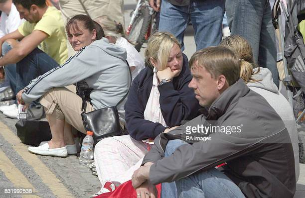 Hundreds of local residents queue for free Robbie Williams tickets outside Croke park in Dublin where the star is holding a concert on June 9.