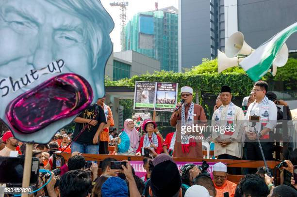 Hundreds of Malaysian muslim protesters march to the US Embassy during a protest in Kuala Lumpur Malaysia on December 15 2017 They are protesting...