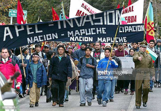 Hundreds of Mapuche people who protest against the AsiaPacific Economic Cooperation and demand their ancestral lands are returned to them march...