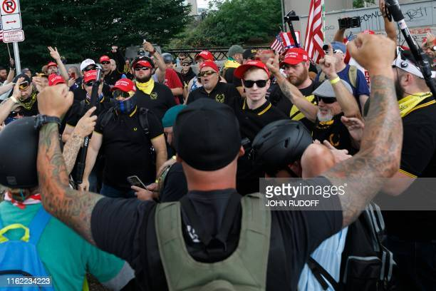 Hundreds of members of farright groups face some Antifa protestors during The End Domestic Terrorism rally at Tom McCall Waterfront Park on August 17...