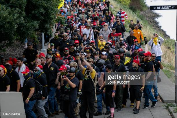 Hundreds of members of farright groups march during The End Domestic Terrorism rally at Tom McCall Waterfront Park on August 17 2019 in Portland...