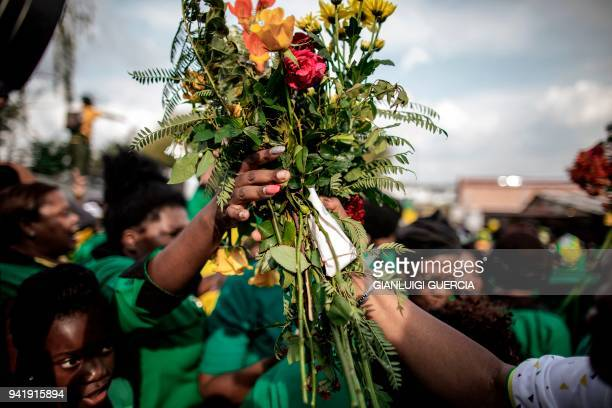 Hundreds of members of the African National Congress Women's League bring flowers to rally to commemorate the late South African antiapartheid...