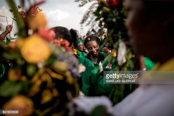 Hundreds of members of the African National Congress Women's League bring flowers to lay outside the home of the late South African antiapartheid...