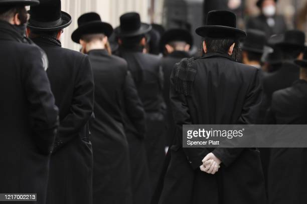 Hundreds of members of the Orthodox Jewish community attend the funeral for a rabbi who died from the coronavirus in the Borough Park neighborhood...