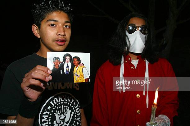 Hundreds of Michael Jackson fans converged on Neverland Ranch for a candlelight vigil in support of Jackson January 15 2004 in Santa Ynez California