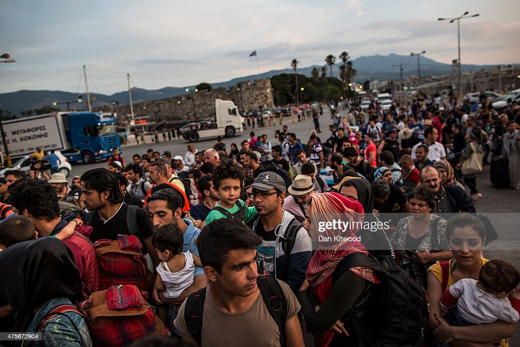 Hundreds of migrant men, women and children along with tourists and locals board a ferry bound for Athens on June 04, 2015 in Kos, Greece. Many migrants are continuing to arrive on the Greek Island of Kos from Turkey. The Island has recently seen a drop in tourist numbers which has been attributed to negative reports on the migrant crisis that is continuing to grip the area. Many migrants are continuing to arrive on the Greek Island of Kos from Turkey. Around 30,000 migrants have entered Greece so far in 2015, with the country calling for more help from its European Union counterparts.