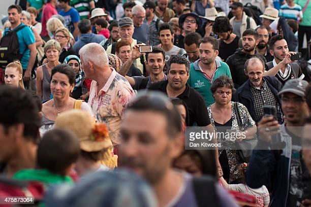 Hundreds of migrant men women and children along with tourists and locals board a ferry bound for Athens on June 04 2015 in Kos Greece Many migrants...