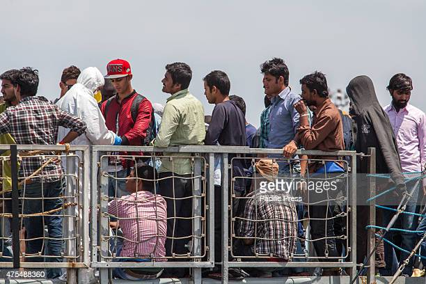 Hundreds of migrants arrived in Palermo Italy aboard the Irish military ship El Eithne after a rescue mission from the Straight of Sicily 410 rescued...