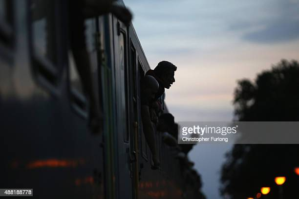Hundreds of migrants packed on a train at Roszke train station destined for the Austrian border after the hungarian authorities closed the open...