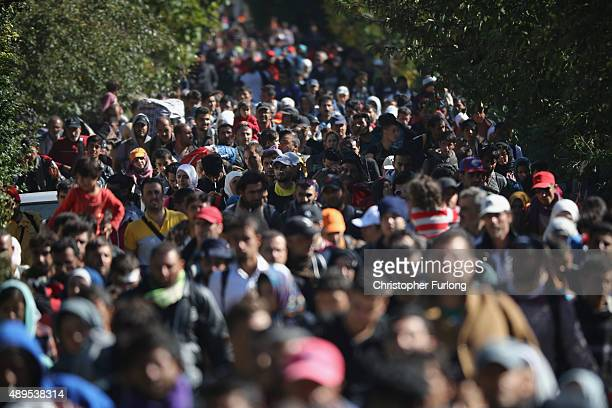 Hundreds of migrants who arrived on the second train today at Hegyeshalom on the Hungarian and Austrian border walk the four kilometres into Austria...