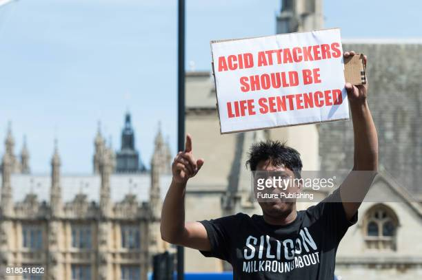 Hundreds of motorcycle drivers gather in Parliament Square in central London to protest against acid attacks and motorcycle theft on July 18 2017 in...