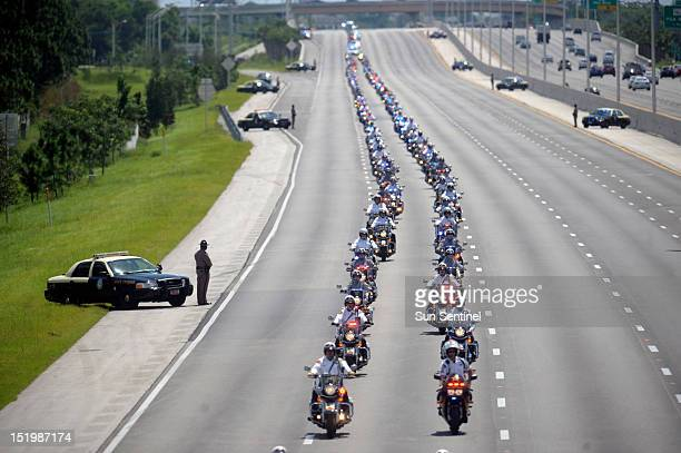 Hundreds of motorcycle officers lead the funeral procession of Jupiter Police Officer Bruce St Laurent Friday September 14 in Palm Beach Gardens...