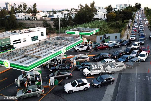 Hundreds of motorists queue at a gas station in Zapopan Jalisco State on January 6 2019 as shortages have been reported in several other Mexican...