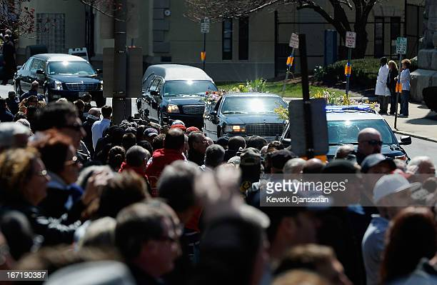 Hundreds of mourners line the street as the hears arrives at St Joseph Catholic Church for the funeral of Krystle Campbell a victim of the Boston...