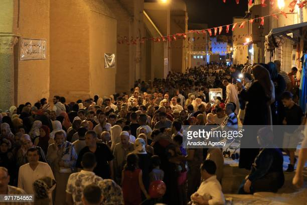 Hundreds of Muslims make their way to Great Mosque of Kairouan on the Laylat al-Qadr in Kairouan, Tunisia on June 12, 2018.