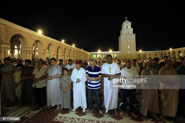 Hundreds of Muslims perform a prayer at Great Mosque of Kairouan on the Laylat al-Qadr in Kairouan, Tunisia on June 12, 2018.