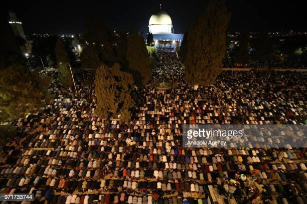 Hundreds of Muslims perform a prayer on the Laylat al-Qadr at Al-Aqsa Mosque Compound in Jerusalem on June 11, 2018.