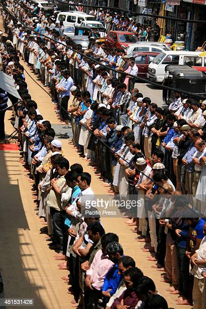 Hundreds of Muslims pray in the streets during the first day of the fasting month of Ramadan in Srinagar the summer capital of Kashmir India During...