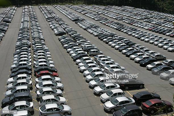 BURLEIGH Hundreds of new cars of US carmaker General Motors remain at the GM car park in the automobile pole of Sao Bernardo do Campo some 25 km...