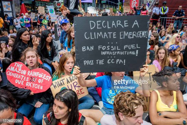 Hundreds of New York City students, young people and climate activists gathered at Columbus Circle for a rally followed by a march and die-in to...