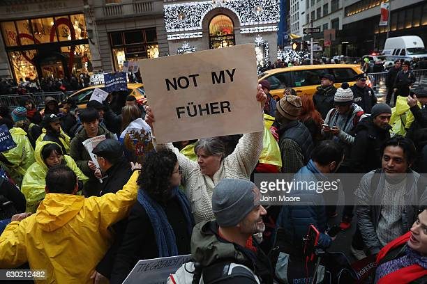 Hundreds of New Yorkers mark International Migrants Day by protesting outside Trump Tower after marching from UN on December 18 2016 in New York City...
