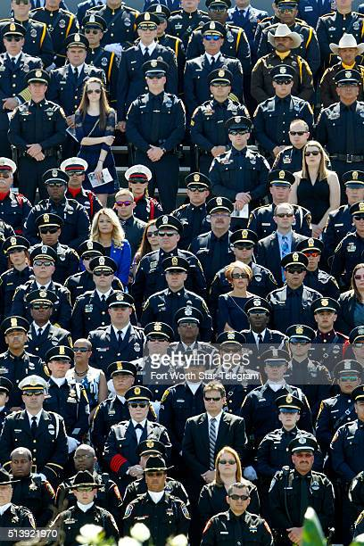Hundreds of officers from different agencies at Pennington Field in Fort Worth Texas attend a memorial service for Euless Texas police officer David...