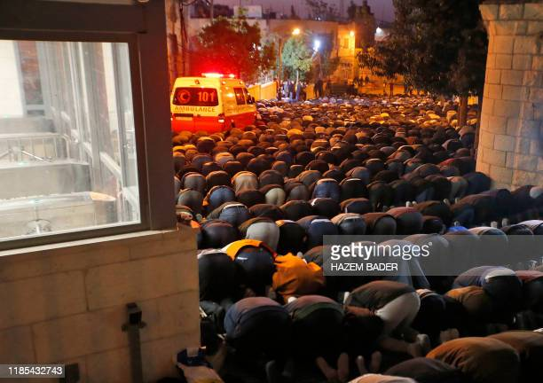 Hundreds of Palestinian Muslim worshippers gather for an early morning prayer around the Ibrahimi Mosque or the Tomb of the Patriarch in the West...